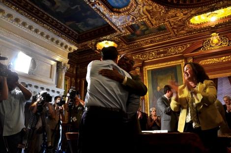 Gov. Scott Walker returns to the Capitol following victory in a statewide attempt to recall him. Wisconsin Housing and Economic Development Authority Executive Director Wyman Winston hugs him as the cabinet greets the governor with a standing ovation.
